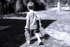 Toddler carrying his milk from the farm Stock Photo