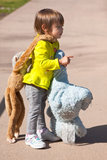 Toddler carrying stuffed animals Stock Images