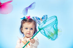 Toddler catching butterflies Stock Images