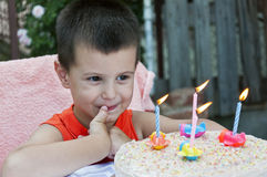 Toddler celebrating birthday. Boy with four candles on cake celebrating birthday Stock Photos
