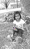 Toddler with cell phone. A toddler with cell phone at the park Royalty Free Stock Images