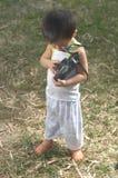 Toddler check camera lenses Stock Photography