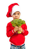 Toddler chef holding broccoli Stock Photo