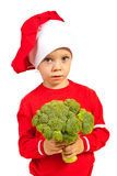 Toddler chef holding broccoli Royalty Free Stock Images