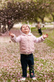 Toddler and cherry blossom stock photo