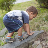 Toddler child climbing Stock Photography