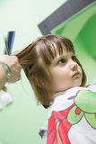 Toddler child getting her haircut Stock Image
