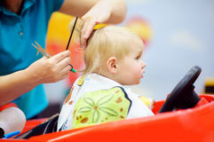 Toddler child getting his first haircut Royalty Free Stock Images