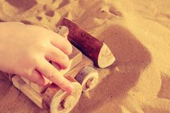 Toddler playing with wooden toy tractor bulldozer royalty free stock photo