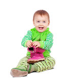 Toddler child holds shoes Royalty Free Stock Images