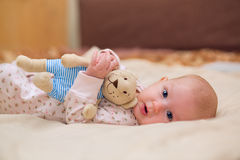 Toddler child. Infant child with a toy in the hands of Royalty Free Stock Photography