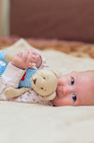 Toddler child. Infant child with a toy in the hands of Royalty Free Stock Images