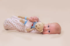 Toddler child. Infant child with a toy in the hands of Stock Image