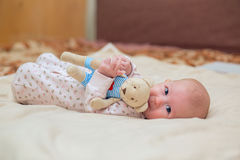 Toddler child. Infant child with a toy in the hands of Royalty Free Stock Photo