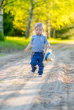 Toddler child outdoors. Rural scene with one year old baby boy with straw hat Royalty Free Stock Images