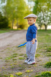 Toddler child outdoors. Rural scene with one year old baby boy wearing flat cap Royalty Free Stock Images