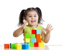 Toddler child playing wooden toy blocks isolated Royalty Free Stock Images