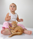 Toddler Child Plays With A Cat Stock Photography