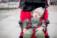 Toddler child is sleeping in the stroller Stock Photo