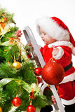 Toddler with a Christmas ball Stock Photography