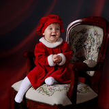 Toddler in a Christmas dress stock image