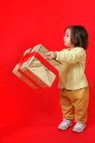 Toddler with a christmas gift Royalty Free Stock Photography