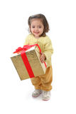 Toddler with a christmas gift stock image