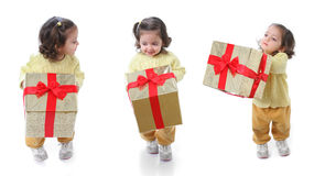 Toddler with a christmas gift royalty free stock images
