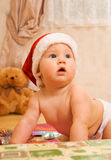 Toddler in Christmas hat Stock Photo