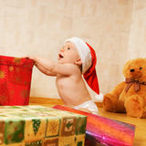 Toddler in Christmas hat Stock Image