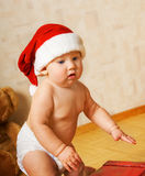 Toddler in Christmas hat Stock Photos