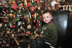 Toddler and christmas tree. Image of a toddler in front of a christmas tree Royalty Free Stock Photography