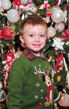 Toddler and christmas tree Stock Image