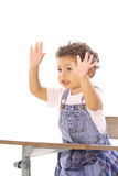 Toddler in class with hands up Royalty Free Stock Photos