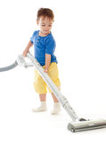 Toddler is cleaning room with vacuum cleaner Royalty Free Stock Images