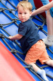 Toddler while climbing stock images
