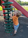 Toddler climbing playground equipment stock images