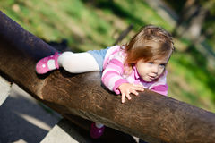 Toddler climbing on the walk Royalty Free Stock Image