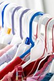 Toddler clothes hanging. In the laundry room. Close up stock photos