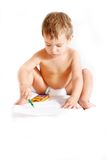 Toddler with colorful pencils Royalty Free Stock Photos
