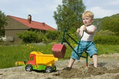 Toddler Construction. Little boy working construction in his sandpit stock images