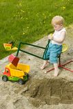 Toddler Construction. Little boy working construction in his sandpit royalty free stock photo