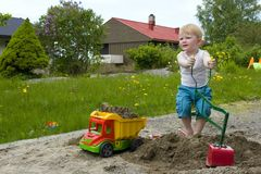 Toddler Construction. Little boy working construction in his sandpit royalty free stock photos