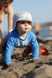 Toddler crawling on beach. Toddler is crawling on the beach, Greece royalty free stock photography