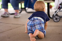 Toddler Crawling on Cement Floor Stock Photos
