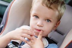 Toddler cute kid sucks a finger Royalty Free Stock Photo