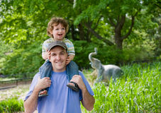 Toddler on Dad's shoulders. Stock Photography