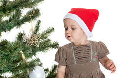 Toddler is decorating a christmas tree Stock Images