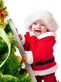 Toddler decorating Christmas tree Stock Photo