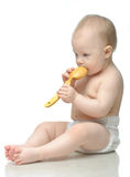 Toddler in diaper playing with wooden spoon Stock Photography
